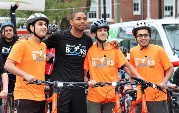 Passion for literacy inspires alumnus Bryant to 'bike for books'